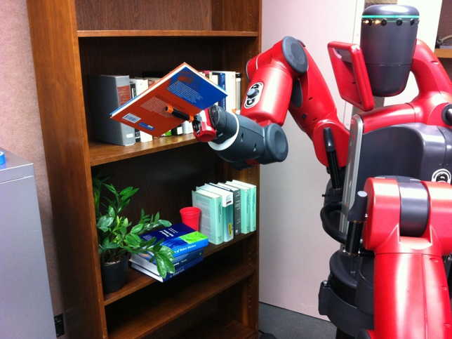 The Baxter robot uses fast parallel and cache-aware motion planners to move a book on a shelf.